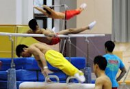 Gymnasts train for the 2012 Chinese Olympic team at the Sports Administration training centre, in Beijing in 2011. China&#39;s Olympic athletes and coaches must vow to reject performance enhancing substances and pass an exam on doping if they want to participate in the London Games, state press said