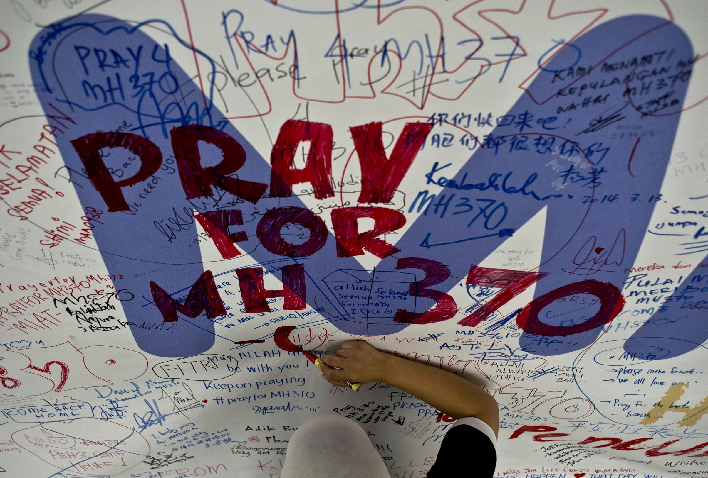 Malaysia declares MH370 an 'accident' as relatives fume