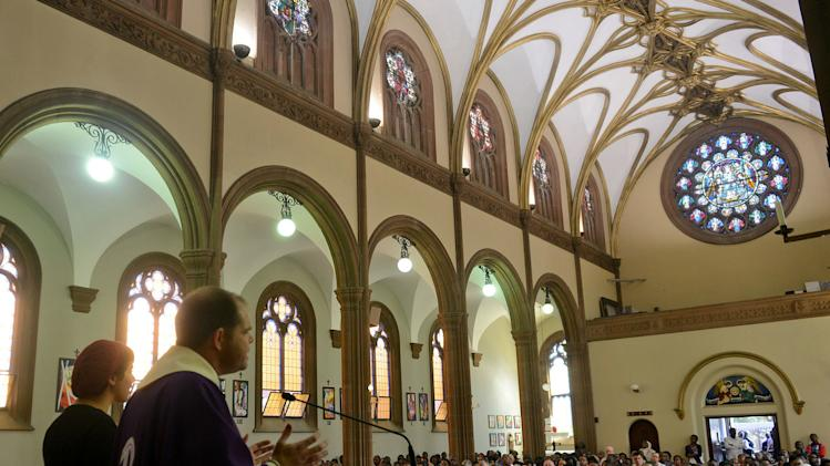 Rev Russell Pollitt preaches during a Mass at the Holy Trinity Catholic Church in Braamfontein,  Johannesburg, Sunday March 3, 2013. Catholics around the world attended the first Sunday masses since Benedict XVI stepped down as pope. Many prayed for a energetic, new leader to reinvigorate what many said was an ailing institution (AP Photo) (AP Photo)