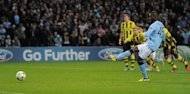 Manchester City&#39;s Italian forward Mario Balotelli (R) scores from a penalty during the UEFA Champions League football match between Manchester City and Borussia Dortmund at the Etihad stadium, in Manchester. The match ended in a 1-1 draw
