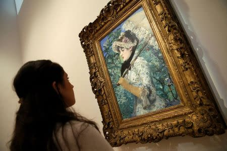 "A Christie's employee looks at Edouard Manet's 1881 celebrated portrait ""Le Printemps,"" at Christie's in New York"
