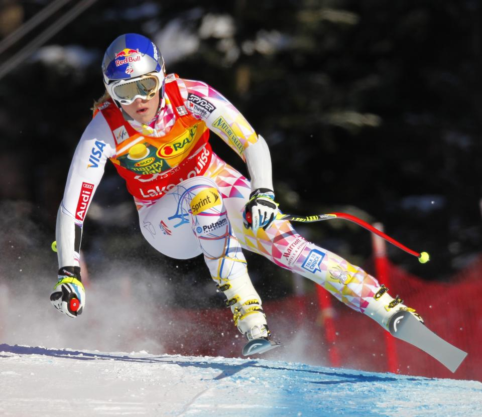 United States' Lindsey Vonn crests a rise during the women's World Cup super-G ski race Sunday, Dec. 4, 2011, at Lake Louise, Alberta. (AP Photo/The Canadian Press, Frank Gunn)
