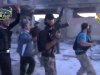 In this image from amateur video obtained by a group which calls itself Ugarit News, shows rebel fighters celebrating after purportedly capturing an army base in Nairab, northwestern Syria, Thursday, May 23, 2013. The video is consistent with independent AP reporting. Rebel fighters captured an army base late Wednesday, a rare victory after a series of battlefield setbacks, the Britain-based Syrian Observatory for Human Rights, a pro-opposition group said. The group said scores of pro-regime troops and more than a dozen rebels were killed in the battle for the base, near the northwestern town of Nairab. (AP Photo/Ugarit News via AP video)