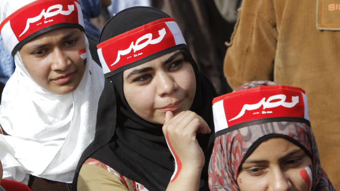 """Egyptian pro-military supporters wear scarves with Arabic reading, """"Egypt,"""" during a protest in Cairo, Egypt, Friday, March 1, 2013. Hundreds of pro-military supporters gathered to reject the Muslim Brotherhood and President Mohammed Morsi's rule calling for the military to return to power.  (AP Photo/Amr Nabil)"""