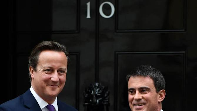 British Prime Minister David Cameron (L) meets French Prime Minister Manuel Valls outside 10 Downing Street in London, on October 6, 2014