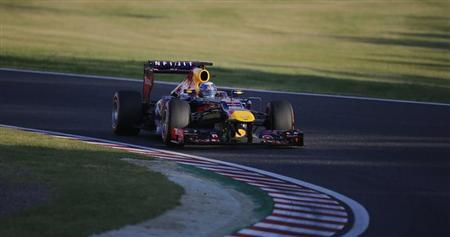 Red Bull Formula One driver Sebastian Vettel of Germany races during the Japanese F1 Grand Prix at the Suzuka circuit October 13, 2013. REUTERS/Issei Kato