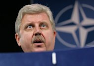 "Ukraine's then Foreign Minister Volodymyr Khandogiy pictured at NATO headquarters in Brussels in December 2007. Khandogiy, now Ukraine's ambassador to London, on Friday criticised a decision by British ministers not to attend group stage games of Euro 2012 because of concerns about ""selective justice"" in Ukraine"