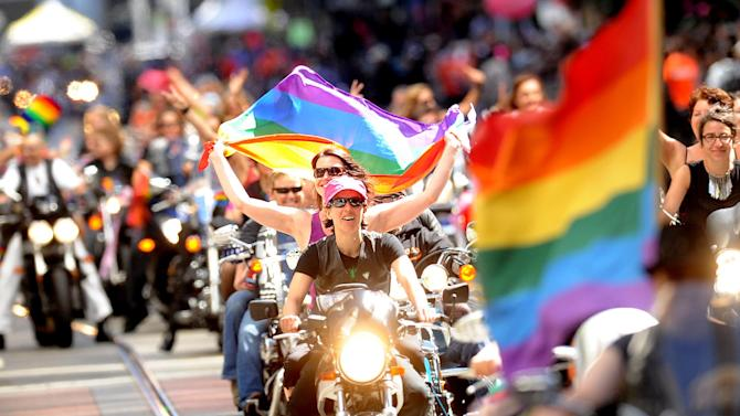 "A contingent of ""Dykes of Bikes"" kicks off San Francisco's 42nd annual gay pride parade on Sunday, June 24, 2012. (AP Photo/Noah Berger)"