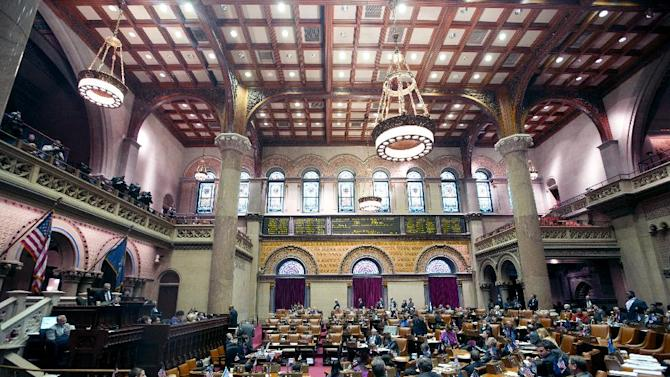 Legislators listen as members explain their vote on New York's Secure Ammunition and Firearms Enforcement Act in the Assembly Chamber at the Capitol on Tuesday, Jan. 15, 2013, in Albany, N.Y.  New York's Assembly passed the toughest gun control law in the nation and the first since the Newtown, Conn., school shooting, calling for a tougher assault weapons ban and provisions to try to keep guns out of the hands of the mentally ill who make threats. The measure passed, 104-43. (AP Photo/Mike Groll)