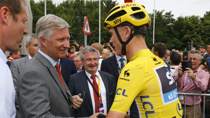 Belgium's King Philippe shakes hands with the race leader and yellow jersey holder, Team Sky rider Chris Froome of Britain, before the 4th stage of the 102nd Tour de France cycling race from Seraing to Cambrai