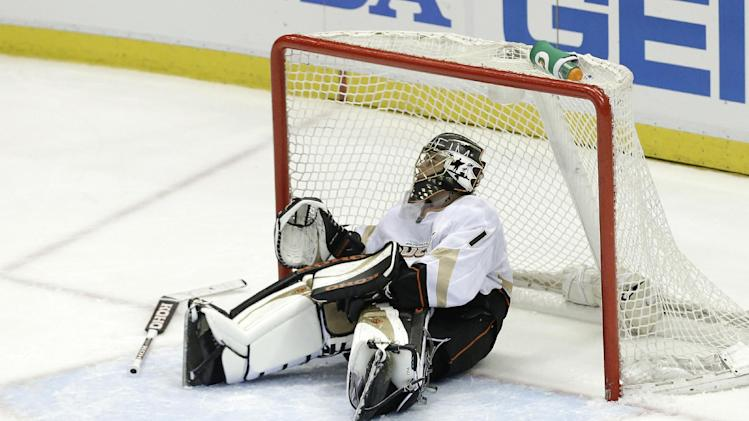 Anaheim Ducks goalie Jonas Hiller (1), of Switzerland,  sits in the net after giving up the game winning goal to Detroit Red Wings center Damien Brunner (24), of Switzerland, in overtime of Game 4 of a first-round NHL hockey Stanley Cup playoff series in Detroit, Monday, May 6, 2013. (AP Photo/Paul Sancya)