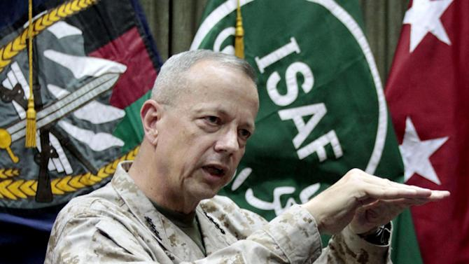 FILE - This July 22, 2012 file photo shows U.S.  Gen. John Allen, top commander of the NATO-led International Security Assistance Forces (ISAF) and US forces in Afghanistan gestures during an interview with the Associated Press in Kabul, Afghanistan. A diminished but resilient al-Qaida, whose 9/11 attacks drew America into its longest war, is attempting a comeback in the country's mountainous east even as U.S. and allied forces wind down their combat mission and concede a small but steady toehold to the terrorist group. (AP Photo/Musadeq Sadeq, File)