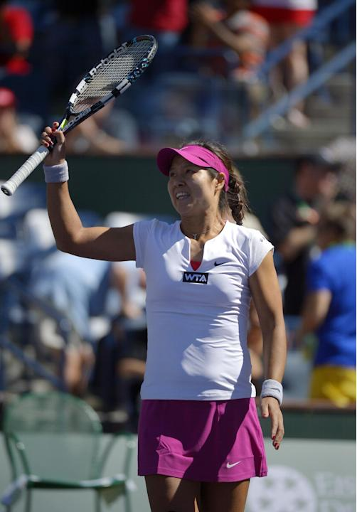 Li Na, of China, celebrates after defeating Zheng Jie, of China, 6-1, 7-5 in their match at the BNP Paribas Open tennis tournament, Saturday, March 8, 2014, in Indian Wells, Calif