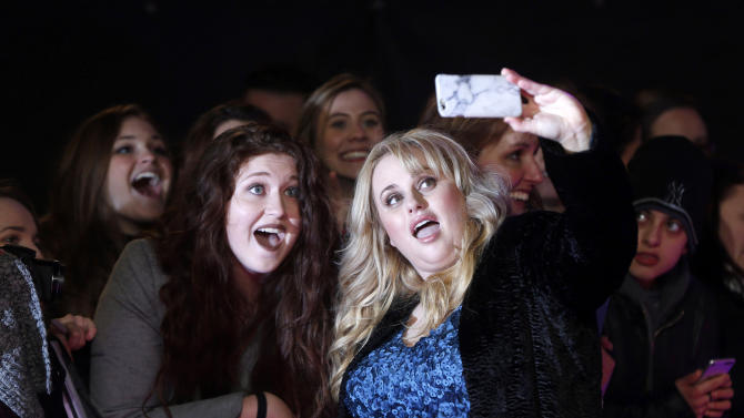 "Australian actress Rebel Wilson poses for a selfie with a fan at the European premiere of the film ""How to be Single"" in London"