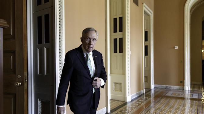 FILE -This June 24, 2014, file photo shows Senate Majority Leader Harry Reid of Nevada on his way to speak to reporters on Capitol Hill in Washington. After changing Senate rules to speed President Barack Obama's nominees through the Senate, Reid has started demanding 60-vote majorities for virtually everything else, most recently to deny Republican leader Mitch McConnell a chance to block rules limiting carbon emissions. (AP Photo/J. Scott Applewhite, File)