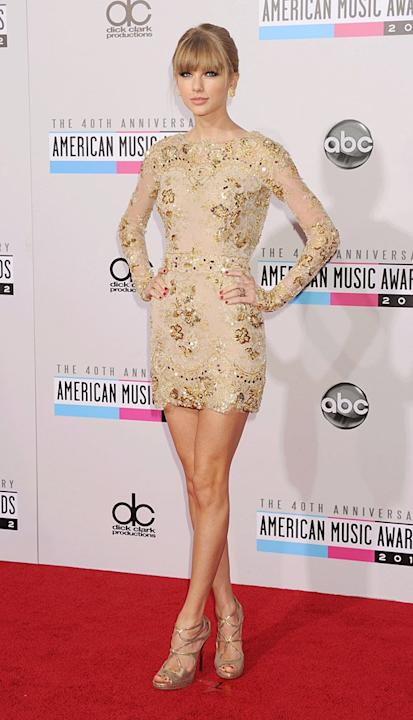 Taylor Swift – who recently gushed about her love of dresses – surprised us when she stepped onto the red carpet at the American Music Awards in this sexy Zuhair Murad mini. While she has been wearing