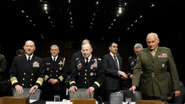 Front row, from left, Adm. James G. Stavridis, U.S. Navy Commander, U.S. European Command and Supreme Allied Commander, Europe; Gen. Charles H. Jacoby, Jr.,Commander, U.S. Northern Command and Commander, North American Aerospace Defense Command; and Gen. John F. Kelly, USMC, Commander, U.S. Southern Command arrive on Capitol Hill in Washington, Tuesday, March 19, 2013, to testify before the Senate Armed Services Committee hearing on U.S. European Command, U.S. Northern Command, and U.S. Southern Command in review of the Defense Authorization Request for Fiscal Year 2014. (AP Photo/Molly Riley)