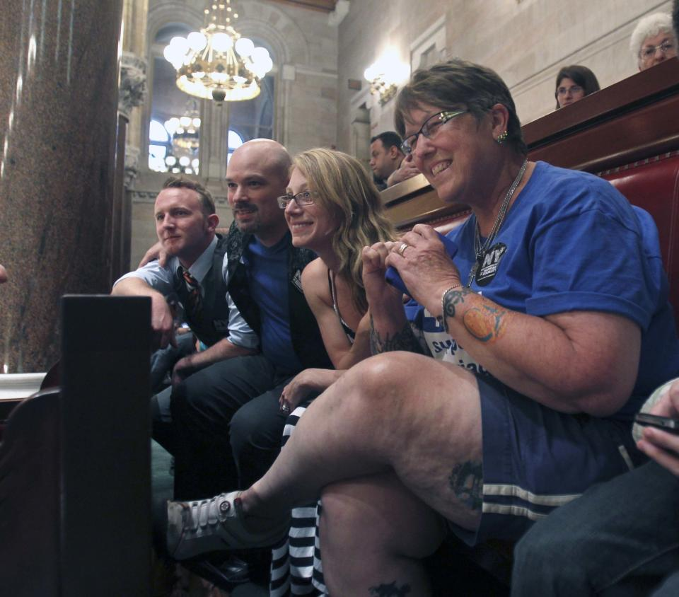 Sharon Wemple of Rotterdam, N.Y., right, and other gay marriage supporters, react in the Senate gallery at the Capitol in Albany, N.Y., upon hearing that the Senate would take a vote on the issue, on Friday, June 24, 2011.  (AP Photo/Mike Groll)