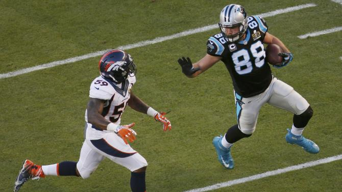 Carolina Panthers' Olsen runs with the ball past Denver Broncos' Trevathan after a reception in the second quarter of the NFL's Super Bowl 50 football game in Santa Clara