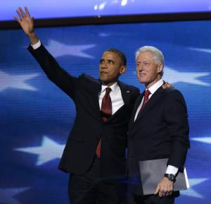 President Barack Obama waves as he joins Former President Bill Clinton during the Democratic National Convention in Charlotte, N.C., on Wednesday, Sept. 5, 2012. (AP Photo/Charles Dharapak)