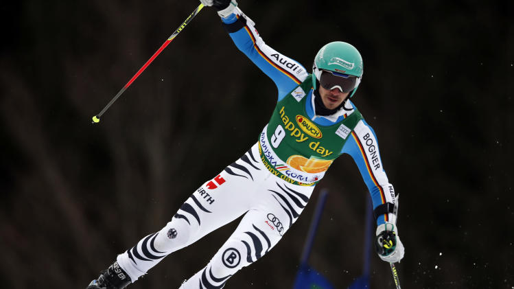 Germany's Felix Neureuther passes a gate during the first run of an alpine ski, men's World Cup giant slalom, in Kranjska Gora, Slovenia, Saturday, March 9, 2013. (AP Photo/Shinichiro Tanaka)