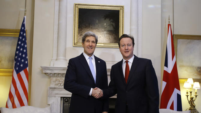 U.S. Secretary of State John Kerry shakes hands with British Prime Minister David Cameron before their meeting at 10 Downing Street in London on Monday, Feb. 25, 2013, during Kerry's first official trip overseas as secretary. (AP Photo/Jacquelyn Martin, Pool)
