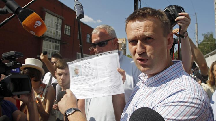 Russian protest leader Alexei Navalny speaks to the media as he arrives for questioning at the headquarters of the Russian Investigation committee in Moscow, Russia, Monday, July 30, 2012. (AP Photo/Misha Japaridze)