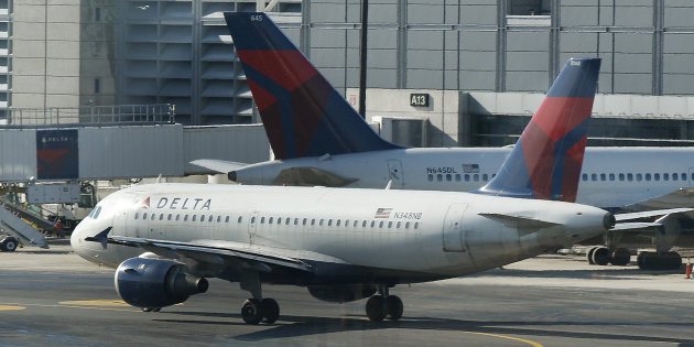 FILE- In this Tuesday, Jan. 24, 2012, file photo, a Delta Airlines plane taxis past a gate at Logan Airport in Boston. Police at Amsterdam&#39;s Schiphol Airport have opened a criminal investigation into how needles got into turkey sandwiches served to passengers on Delta Air Lines flights from Amsterdam to the United States, a spokesman said Tuesday. July 17, 2012. The FBI also is investigating the incidents. (AP Photo/Charles Krupa, File)
