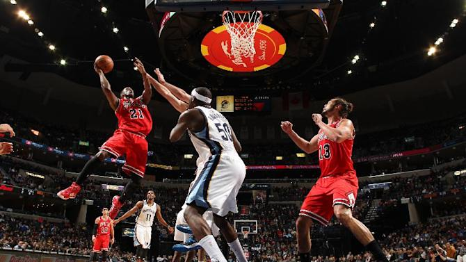 Butler scores 26 as Bulls beat Grizzlies 95-91