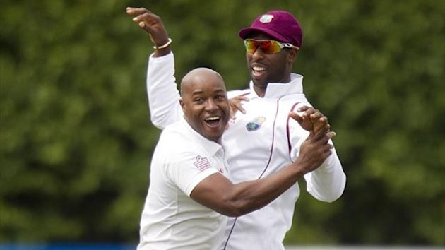 Tino Best (L) and team-mate Kirk Edwards of the West Indies celebrate Peter Fulton of New Zealand being caught out during day one of the second Test (AFP)