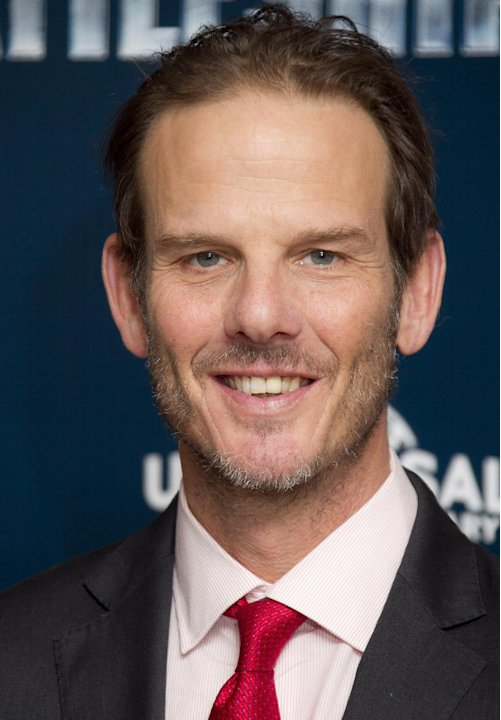 "FILE - In this March 28, 2012 file photo, director Peter Berg poses for photographs at a central London hotel for the photo call of ""Battleship."" Berg, who created TV's ""Friday Night Lights,"" is accus"