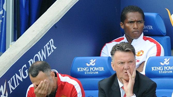 Manchester United manager Louis van Gaal, right, and assistant Ryan Giggs react, during the English Premier League soccer match between Leicester City and Manchester United at King Power Stadium, in Leicester, England, Sunday, Sept. 21, 2014.  (AP Photo/Rui Vieira)