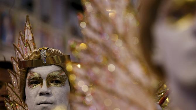 A reveller of the Estacio de Sa samba school performs during the carnaval parade at the Sambadrome in Rio de Janeiro's Sambadrome