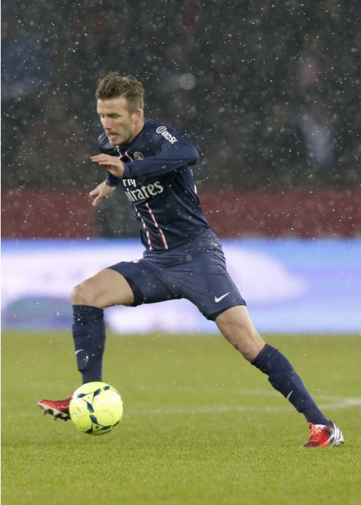 Paris Saint-Germain's Beckham controls the ball during their French Ligue 1 soccer match against Olympic Marseille at Parc des Princes stadium in Paris