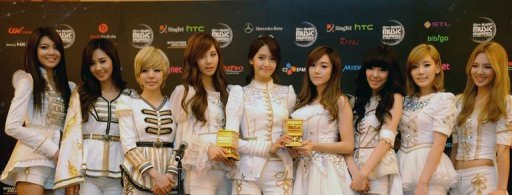 Korea's top girl band, Girls' Generation, pose with their winning trophy at the MNET Asian Music Awards
