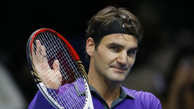 Roger Federer of Switzerland celebrates at match point after beating Janko Tipsarevic of Serbia during their singles tennis match at the ATP World Tour Finals in London Tuesday, Nov. 6, 2012. (AP Photo/Kirsty Wigglesworth)