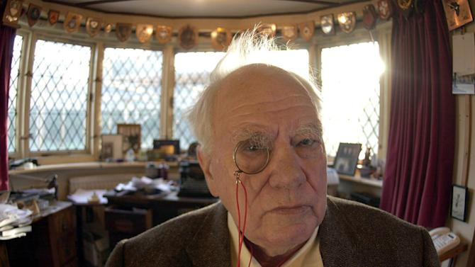 CORRECTS SPELLING OF SELSEY  FILE - In this Dec. 29, 2000 file photo,  British astronomer and broadcaster Patrick Moore at his home in Selsey, West Sussex, England. British astronomer and broadcaster Sir Patrick Moore has died, aged 89, his friends and colleagues have said, on Sunday, Dec. 9, 2012. (AP Photo/ Kirsty Wigglesworth/PA File)  UNITED KINGDOM OUT