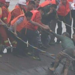 Dramatic Video Shows Rescuers Saving Woman From Capsized Ship In China