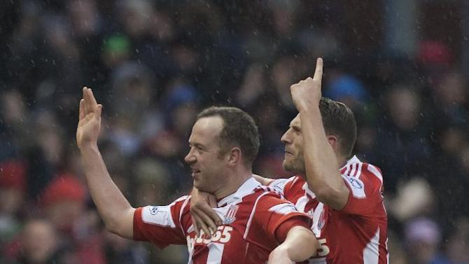 Stoke's Charlie Adam, left, celebrates with teammate Erik Pieters after scoring his second goal against Manchester United during their English Premier League soccer match at the Britannia Stadium, Stoke, England, Saturday Feb. 1, 2014