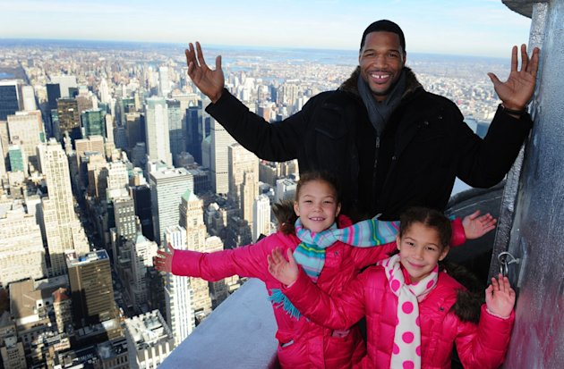 Dec. 6, 2012 - Manhattan, New York, U.S. - MICHAEL STRAHAN, with daughters ISABELLA AND SOPHIA, lights the Empire State Building green and tour the 86th floor Observatory and 103rd floor parapet in celebration of St. Jude Children&#39;s Research Hospital &#39;&#39;Thanks and Giving&#39;&#39; campaign, Thursday, December 6, 2012.