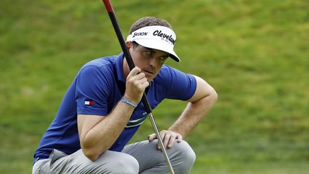 Keegan Bradley of the U.S. lines up a putt on the 17th green as he holds his long belly putter during the first round of the World Challenge golf tournament in Thousand Oaks, California, November 29, 2012 (Reuters)