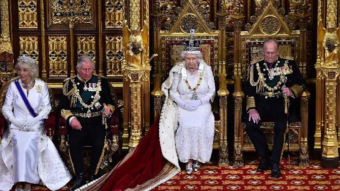 Britain's Queen Elizabeth II, 2nd right, seated on the throne in the House of Lords next to her husband, Prince Philip, Duke of Edinburgh, right, son, Prince Charles, Prince of Wales, 2nd left and his wife Camilla, Duchess of Cornwall, prepares to deliver the Queen's Speech during the State Opening of Parliament at the Palace of Westminster in London Wednesday, May 27, 2015. The State Opening of Parliament marks the formal start of the parliamentary year and the Queen's Speech sets out the government's agenda for the coming session. (Ben Stansall/Pool Photo via AP)