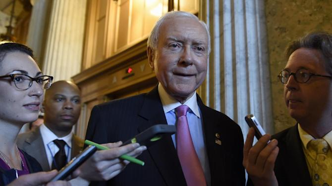 Sen. Orrin Hatch, R-Utah. is surrounded by reporters as he walks to a luncheon with other Senate Republicans on Capitol Hill in Washington, Friday, May 22, 2015. Supporters of President Barack Obama's trade agenda hope to fend off hostile Senate amendments Friday and send a major trade bill to the House, where another fierce debate awaits. Senators also plan to address the government's soon-to-expire authority to collect bulk data on Americans' phone records. (AP Photo/Susan Walsh)