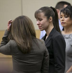 Jodi Arias stands as the jury is excused after the verdict for sentencing was declared a hung jury for her first degree murder conviction at Maricopa County Superior Court in Phoenix, Ariz., on Thursday, May 23, 2013. (AP Photo/The Arizona Republic, David Wallace, Pool)