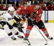 Chicago Blackhawks' Patrick Kane, right, controls the puck against Pittsburgh Penguins' Brandon Sutter during the second period of an NHL preseason hockey game in Chicago, Thursday, Sept. 19, 2013. (AP Photo/Nam Y. Huh)
