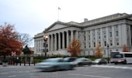 <p>Vehicles drive by the US Treasury Building in Washington on November 15, 2011. With President Barack Obama heading back to Washington, Republicans heaped pressure on Democrats on Wednesday to lay out an 11th-hour deal preventing taxes from rising for all Americans.</p>