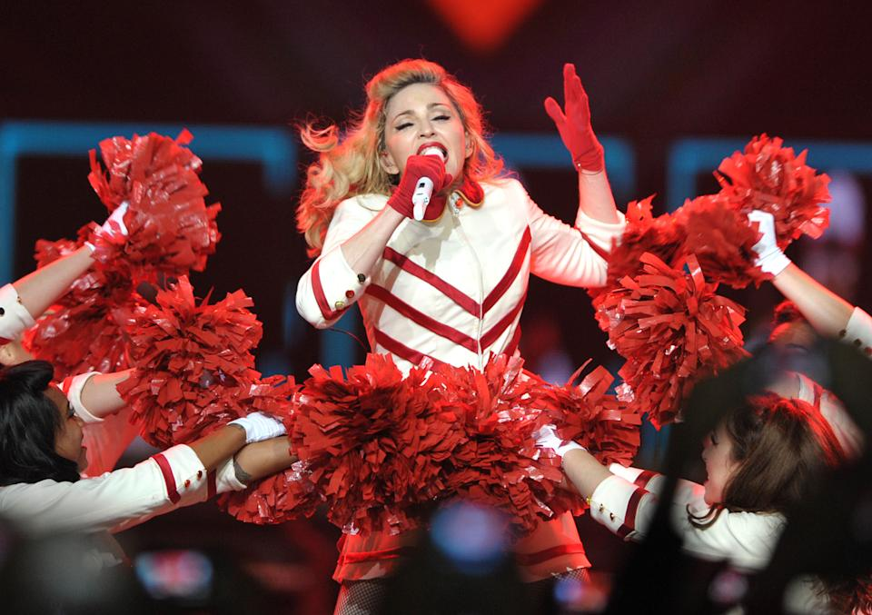 "Madonna performs on the ""MDNA"" tour at Staples Center on Wednesday Oct. 10, 2012 in Los Angeles.  (Photo by John Shearer/Invision/AP)"