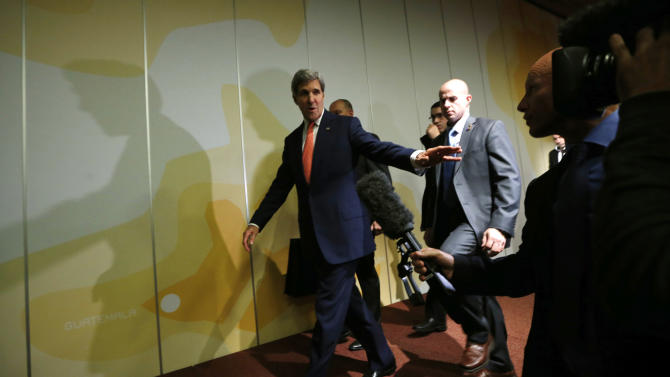 """U.S. Secretary of State John Kerry walks out of a press conference at the end of the Iranian nuclear talks in Geneva, Sunday, Nov. 10, 2013. Nuclear talks with Iran have failed to reach agreement, but Kerry said differences between Tehran and six world powers made """"significant progress."""" (AP Photo/Jason Reed, Pool)"""