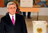 Armenian President Serzh Sarkisian votes at a poling station in Yerevan, on February 18, 2013. Sarkisian was set to win Armenia's presidential election with over 58 percent of the vote, according to near-total official results, with his main rival crying foul early Tuesday