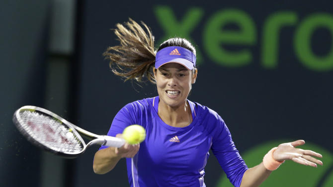 Ana Ivanovic, of Serbia, returns a shot from Sabine Lisicki, of Germany, at the Miami Open tennis tournament, Sunday, March 29, 2015, in Key Biscayne, Fla. (AP Photo/Wilfredo Lee)